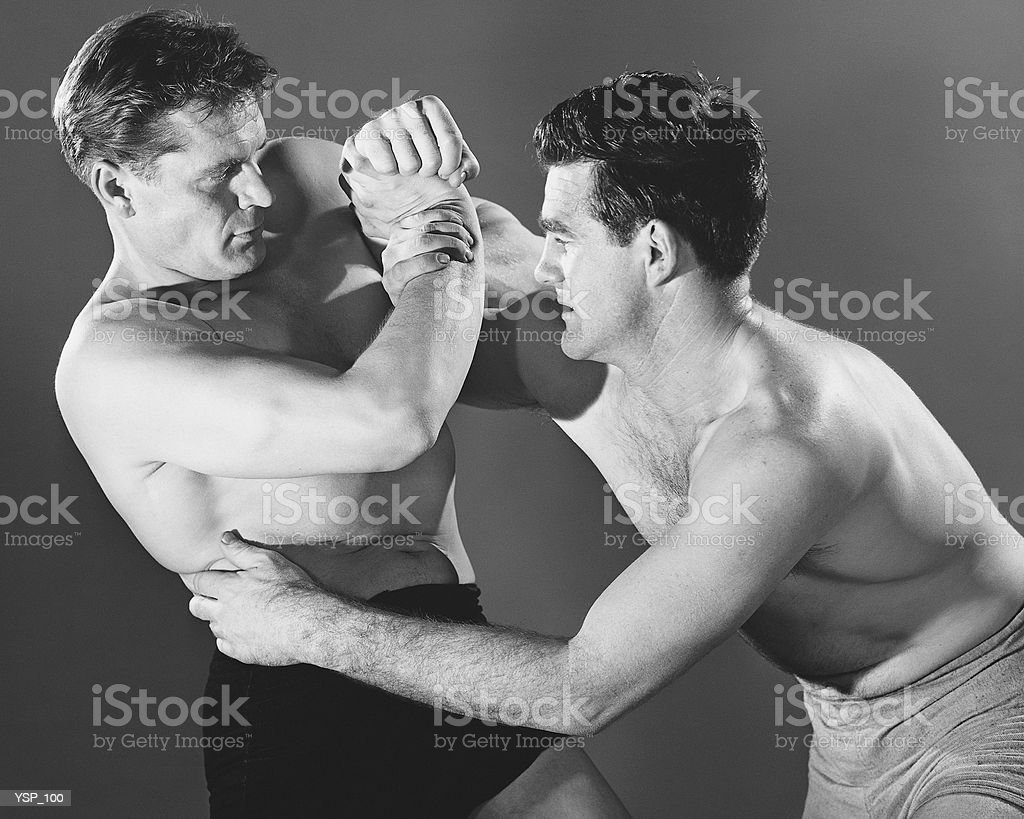 Two men wrestling royalty-free stock photo