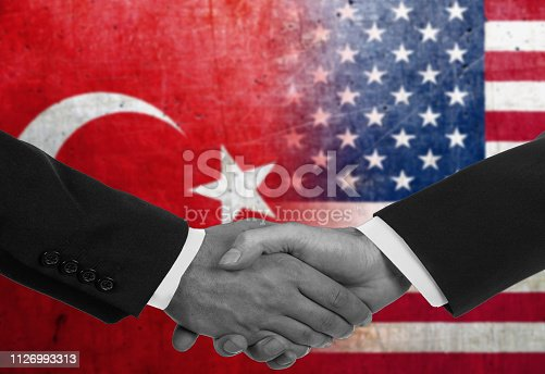 istock Two men/politicians in suits shaking hands - Turkey and United States 1126993313