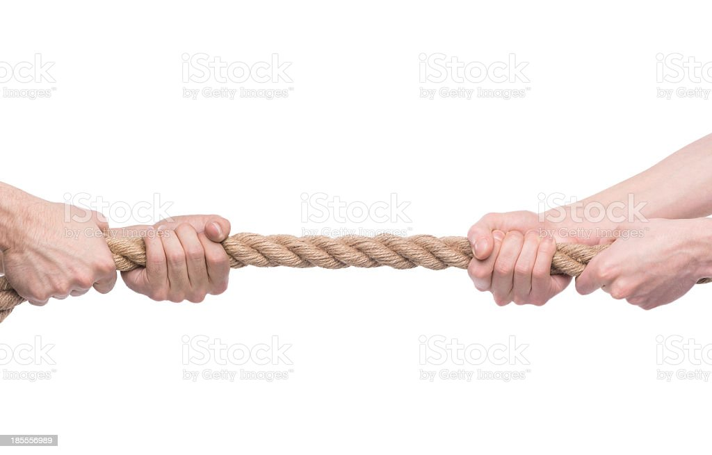 Two men's hands pulling opposite ends of rope stock photo
