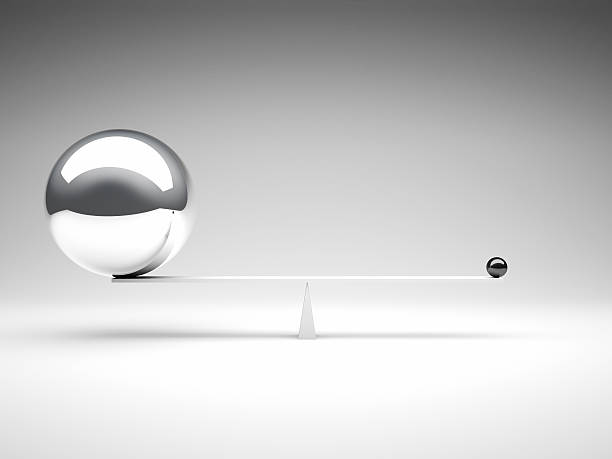 two metal balls balancing on a white balance beam - small stock pictures, royalty-free photos & images