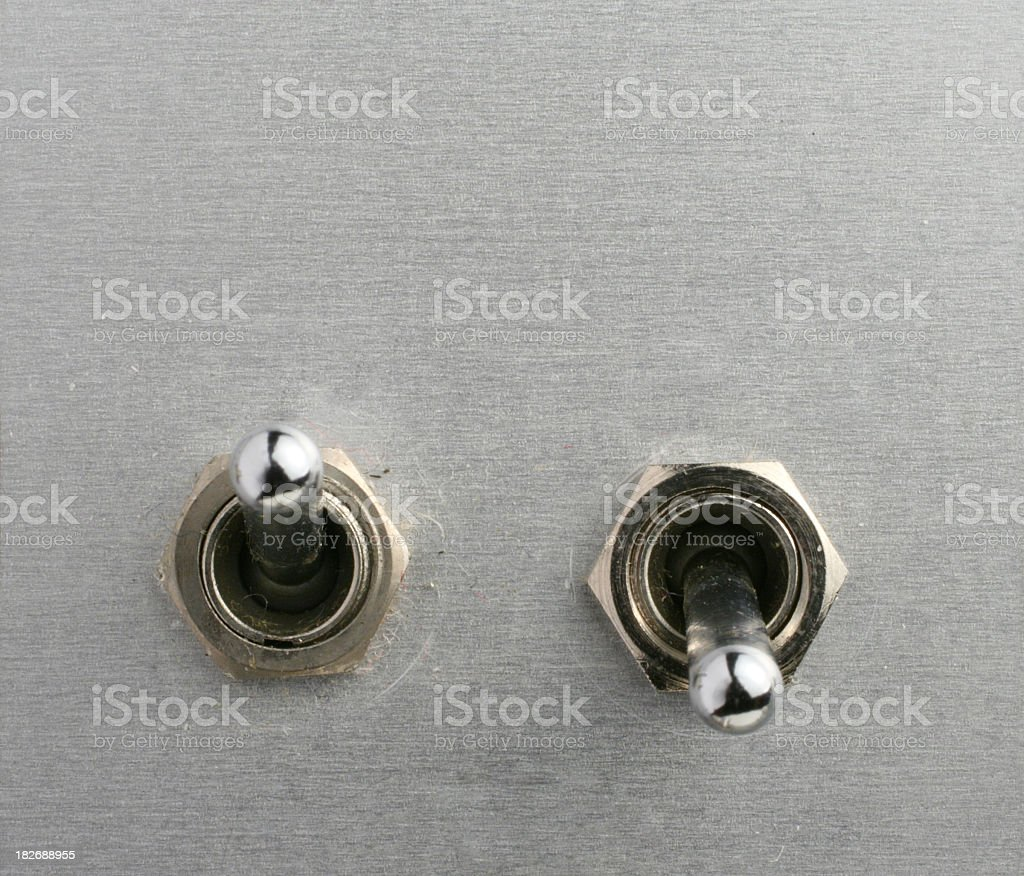 Two metal toggle switches next to one another stock photo