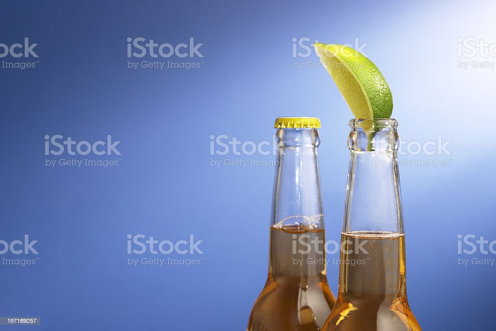 Two Mexican Beers on Blue royalty-free stock photo