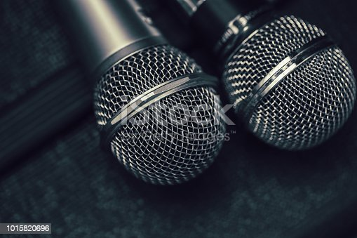 istock Two microphone for duo sing a song or Karaoke concept 1015820696