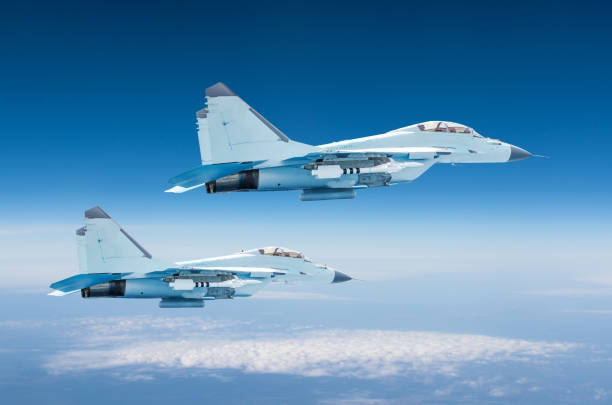 Two military fighters jet aircraft at high altitude, combat mission operation flying high in the sky. Two military fighters jet aircraft at high altitude, combat mission operation flying high in the sky supersonic airplane stock pictures, royalty-free photos & images