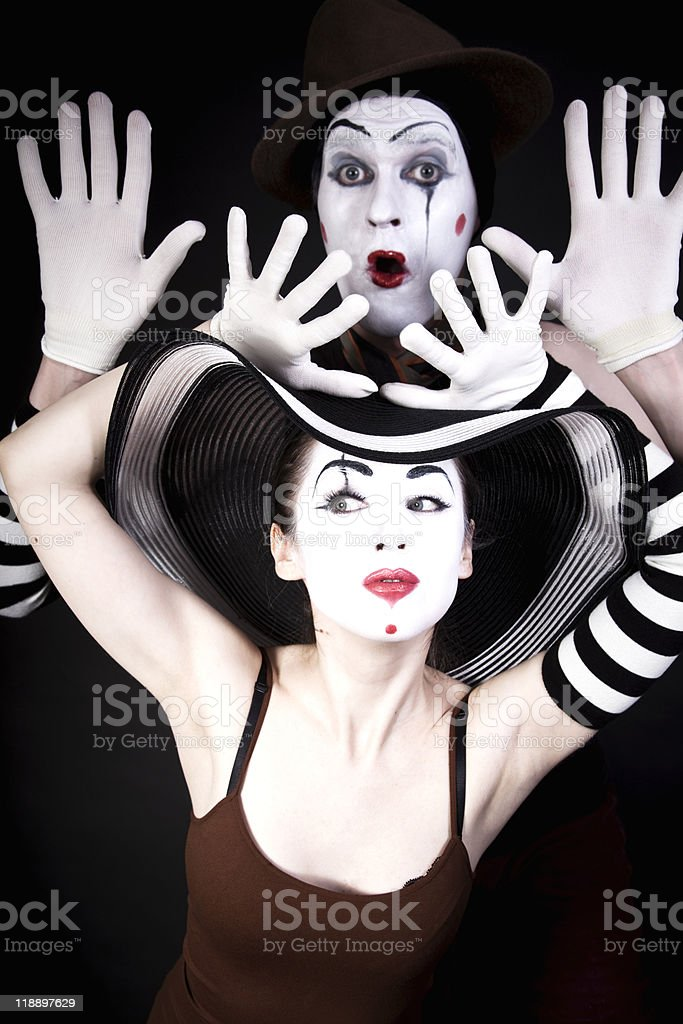 two mimes in hats on black background royalty-free stock photo