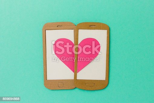istock Two mobile phone screens combining a pink heart 859694868