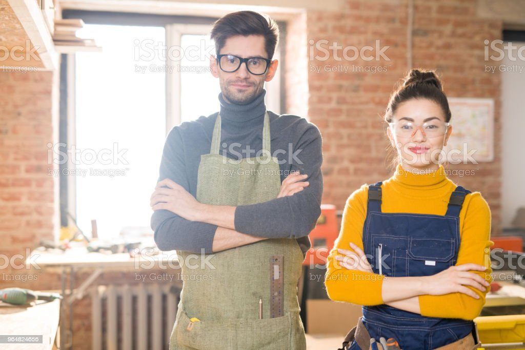 Two Modern Artisans Posing in Workshop royalty-free stock photo
