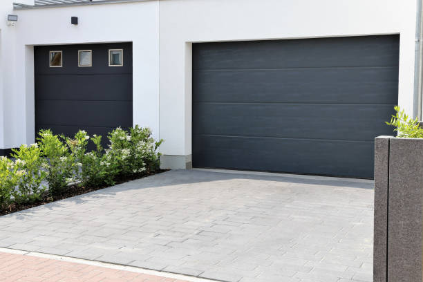 two modern new garage doors (sectional doors) in a residential district - porta foto e immagini stock