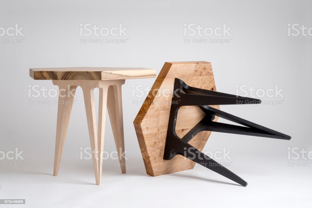 Two Modern Wooden Coffee Tables, One Tilted with Black Legs stock photo