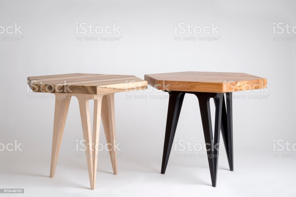 Two Modern Wooden Coffee Tables with Hexagonal Tops stock photo