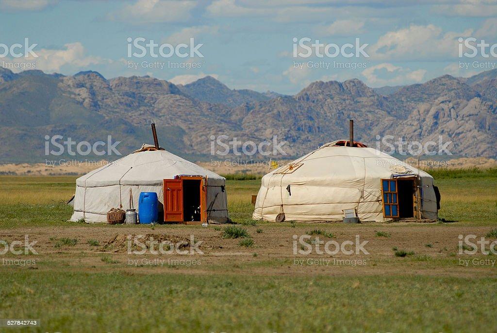 Two Mongolian yurts in steppe, Elsen Tasarhai valley, Mongolia. stock photo