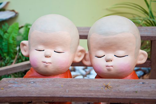 Two monk dolls made from ceramic