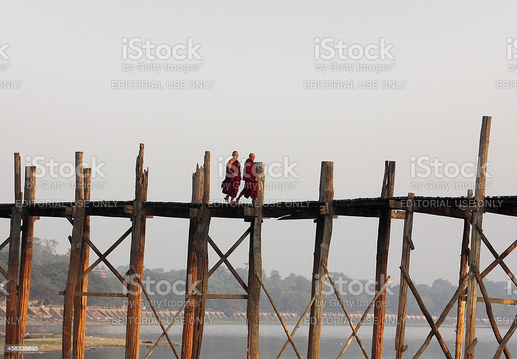 Two monks on U Bein's Bridge royalty-free stock photo