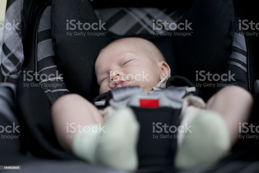 Two month old baby car seat sleeping stock photo