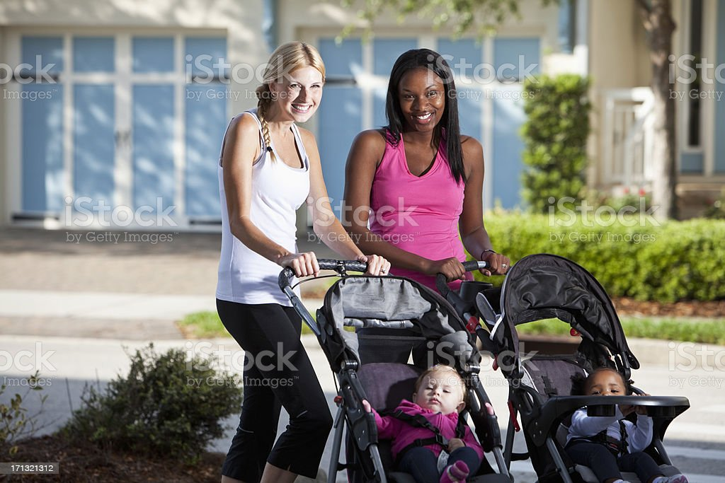 Two mothers with babies in strollers royalty-free stock photo