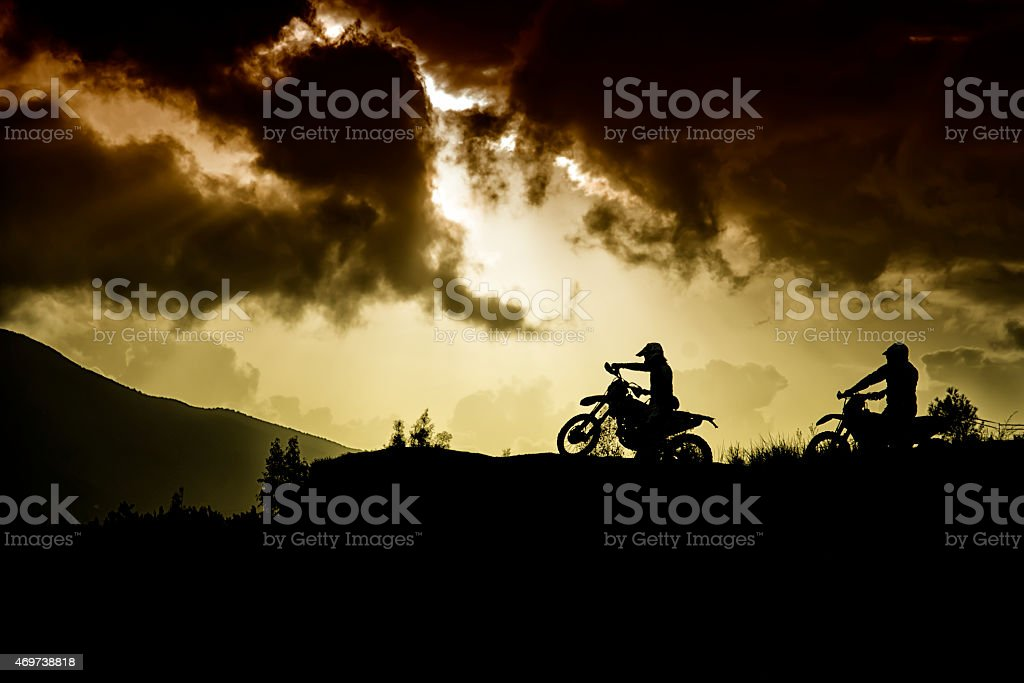 Two motor cross riders on top of a hill stock photo