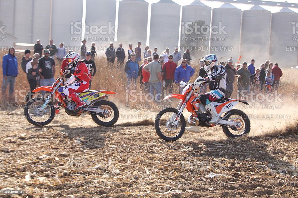 Two motorbikes kicking up trail of dust at rally stock photo