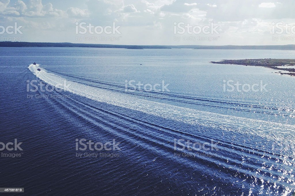 Two motorboats in the White sea stock photo