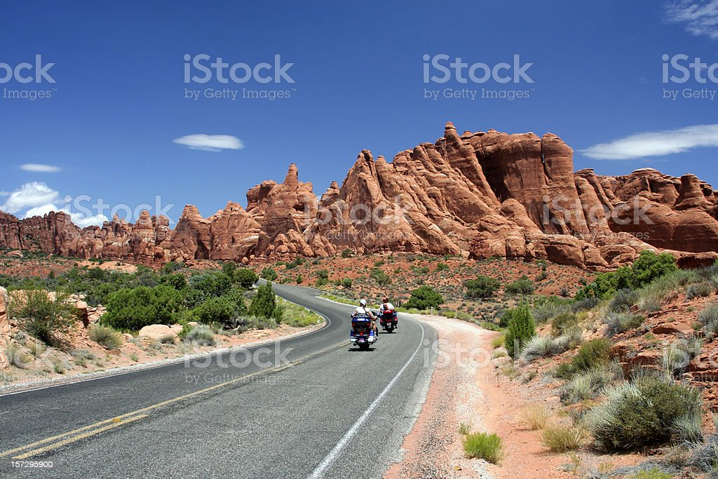 Two motorcycles on a tarred road in the desert royalty-free stock photo