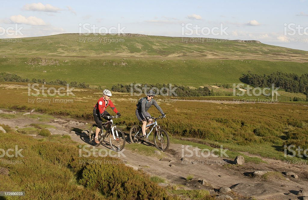 Two Mountain Bikers Peak District National Park - Royalty-free Adult Stock Photo
