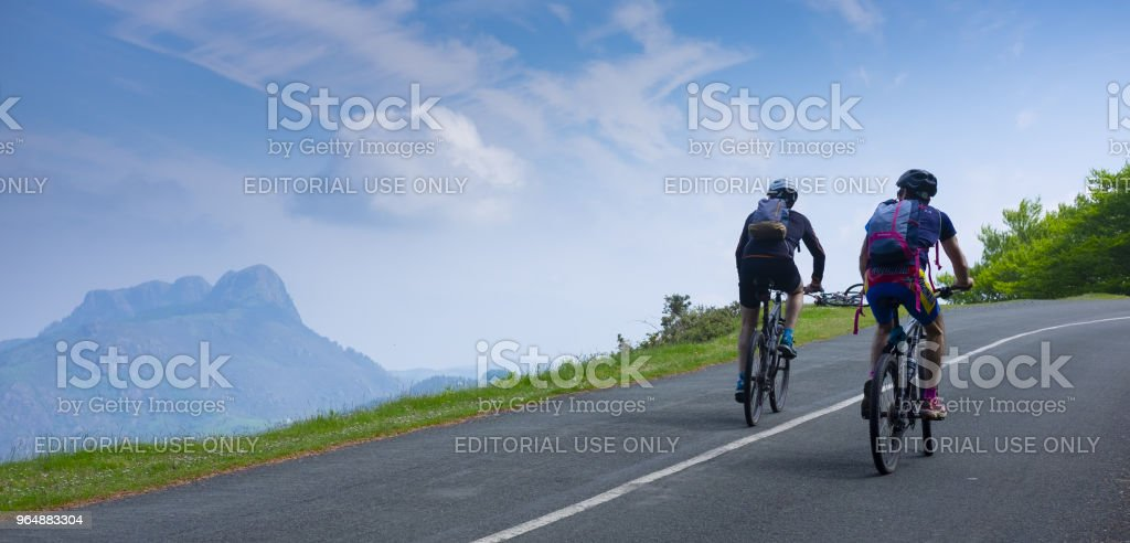 Two mountain bikers riding bike in road, Aiako Harriak Natural Park. royalty-free stock photo