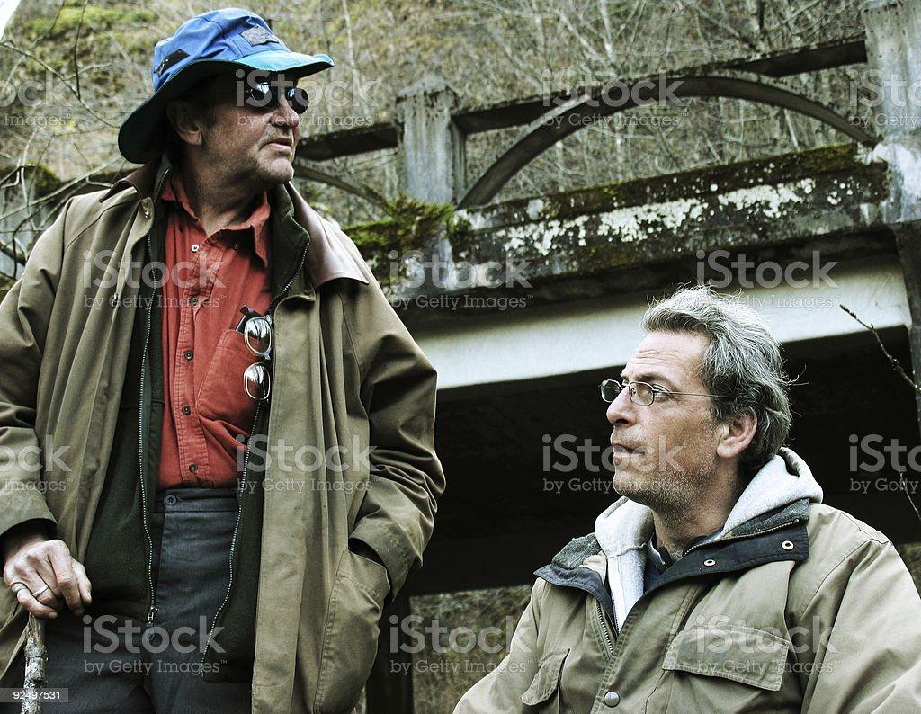 Two Mountain Men Sitting Under Bridge royalty-free stock photo