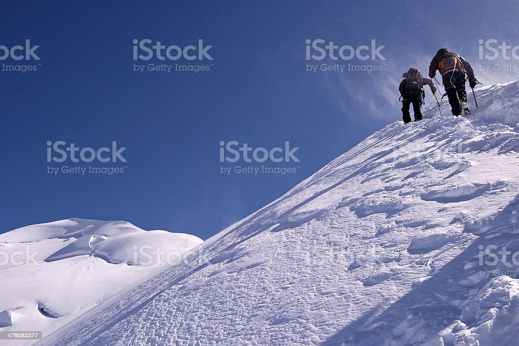 Two mountaineers breaking a trail to Mont Blanc stock photo
