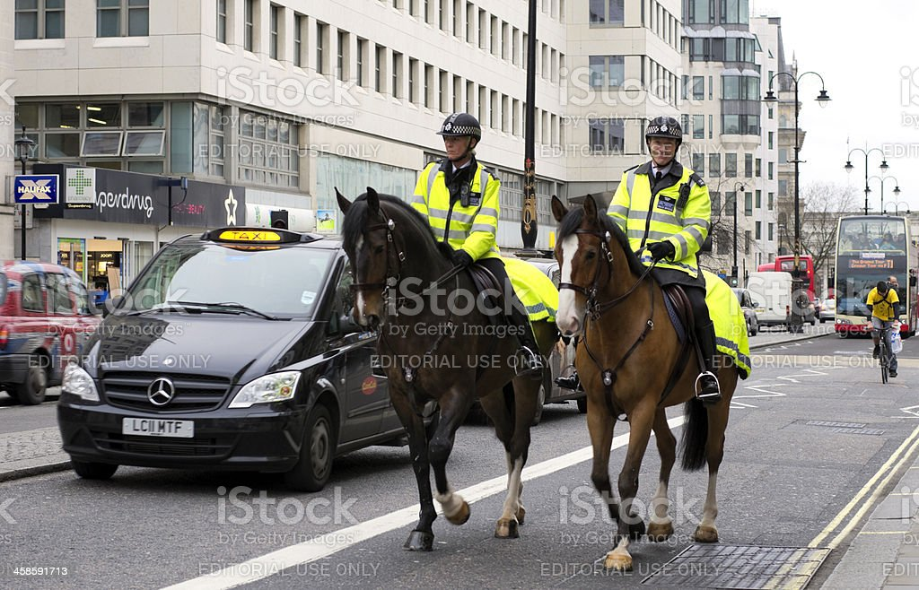 Two mounted Metropolitan Police officers, The Strand, London stock photo