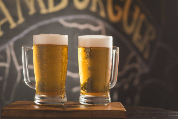 two mugs of chopp on the table two mugs of chopp on the table pilsner stock pictures, royalty-free photos & images