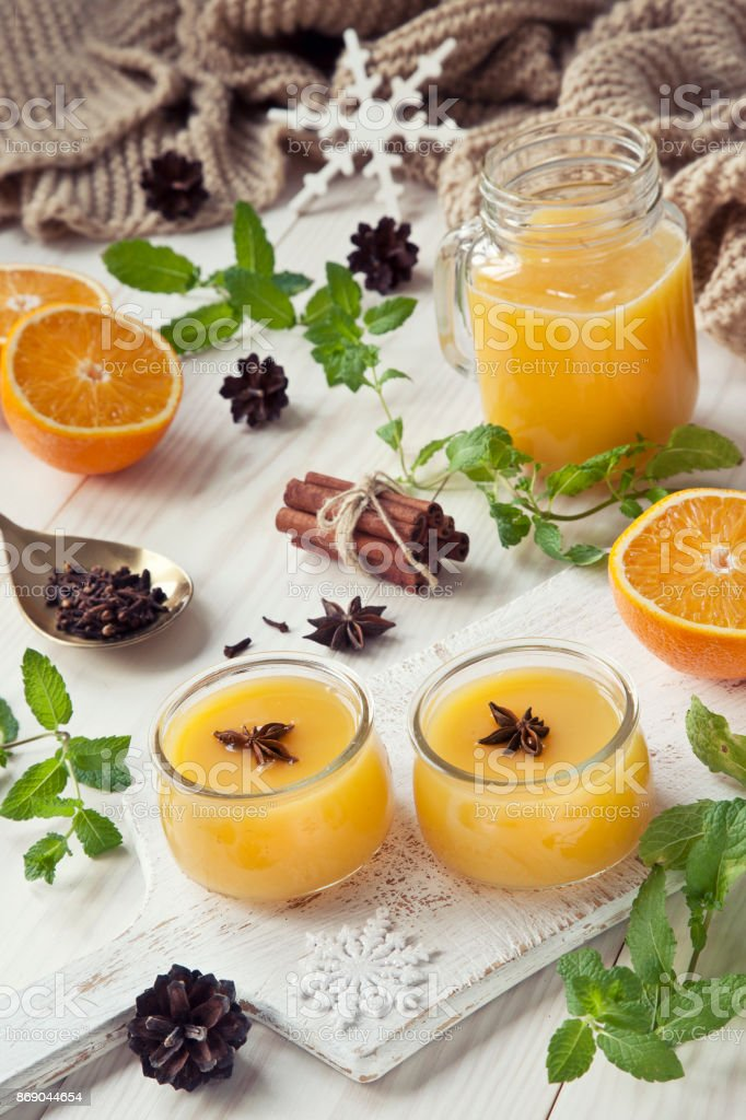 Two mugs of hot fruit drink with spices. Christmas concept with symbols of love. Close up stock photo