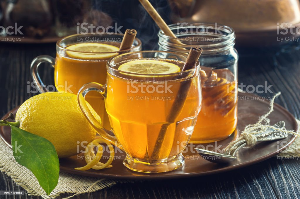 Two Mugs of Lemon Spice Herbal Tea or Hot Toddies stock photo