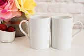 Two Mugs. White Mugs Mockup. Blank White Coffee Mug Mock Up. Styled Photography. Coffee Cup Product Display. Two Coffee Mugs On White Desk. Vase With Pink Roses