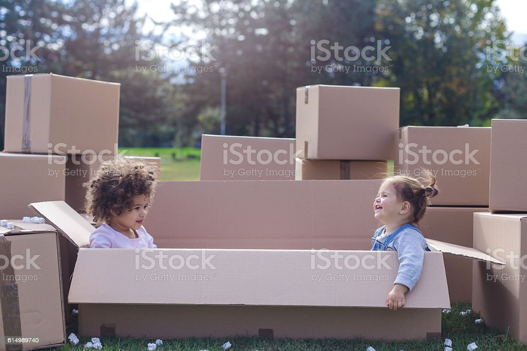 two multi ethnic babies playing together stock photo