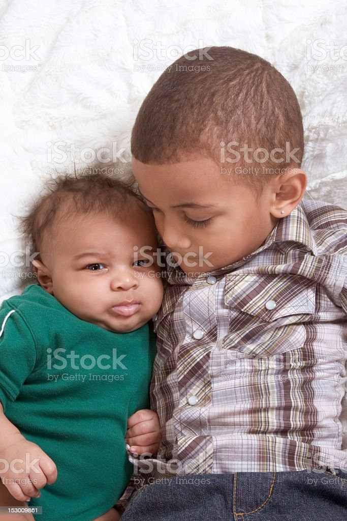 Two multiethnic boys brothers royalty-free stock photo