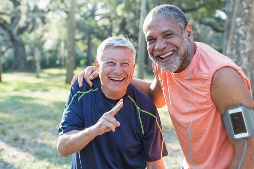istock Two multi-ethnic senior men exercsing in the park 652842710