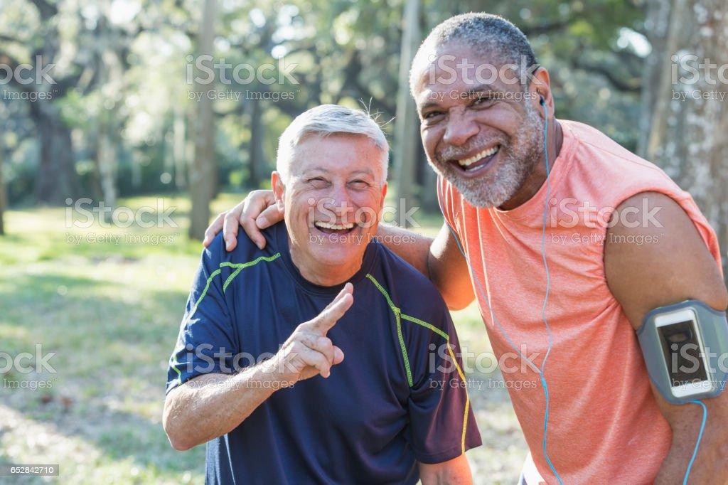 Two multi-ethnic senior men exercsing in the park stock photo