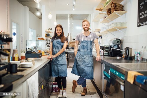 istock Two  multiracial baristas in cafe kitchen 1060887410