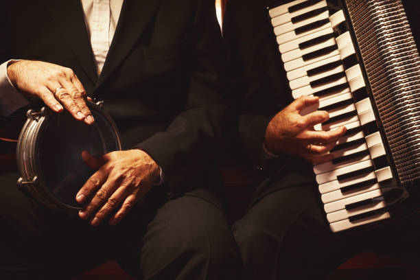 Two Musicians on Their Instruments stock photo