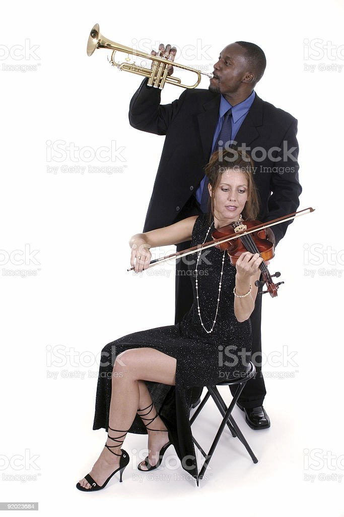 Two Musicians Tuning Up For A Concert 2 royalty-free stock photo