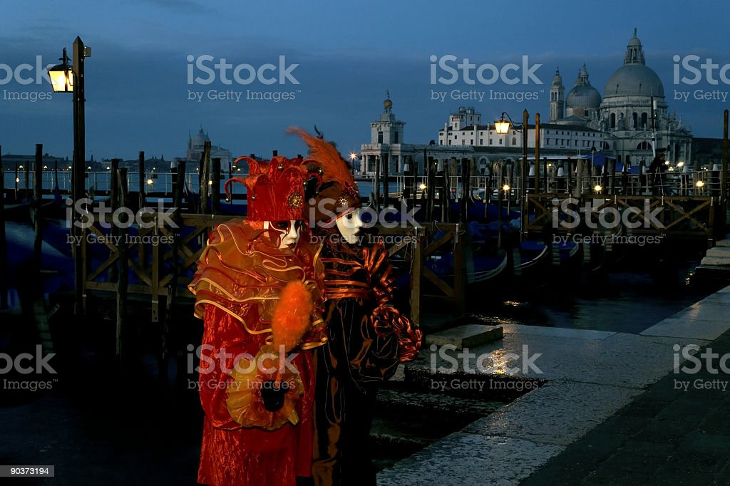 Two mysterious female masks at twilight in Venice (XXL) royalty-free stock photo