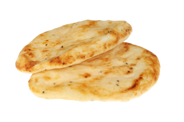 Two naans Two flamebaked naan breads isolated against white naan bread stock pictures, royalty-free photos & images
