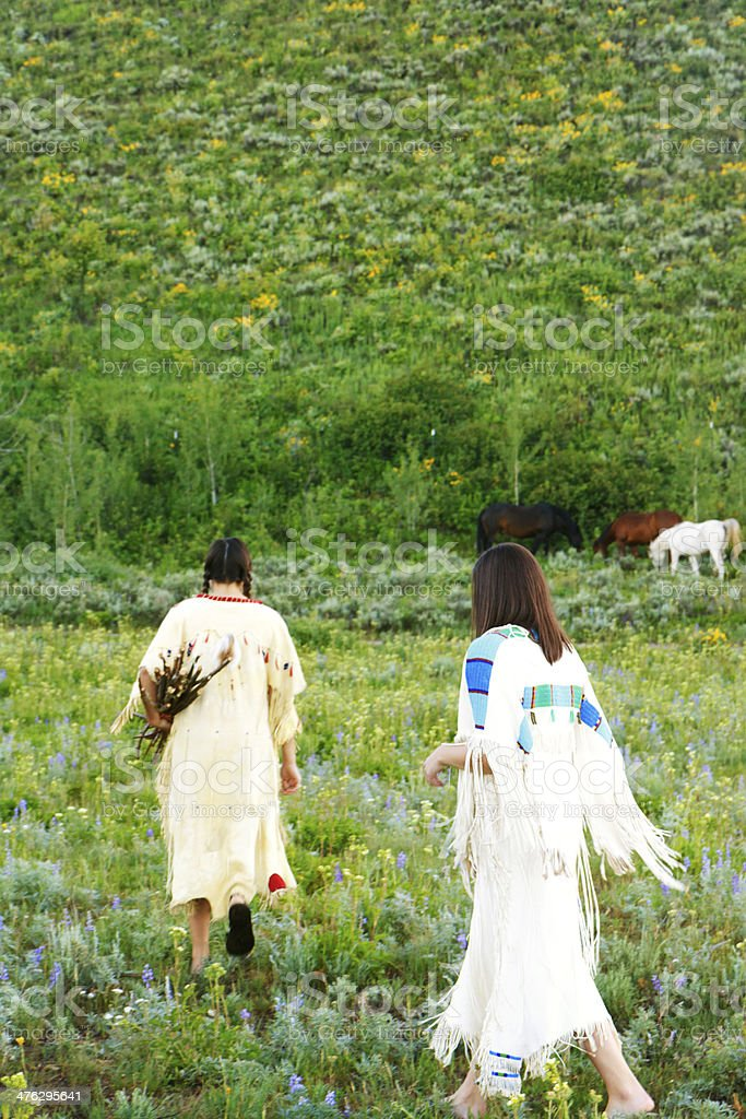 Two Native American Women Collecting Firewood In Deerskin Dresses royalty-free stock photo