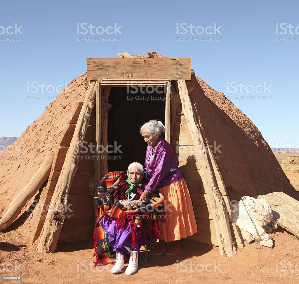 Two Navajo Women Outside Their Hogan stock photo