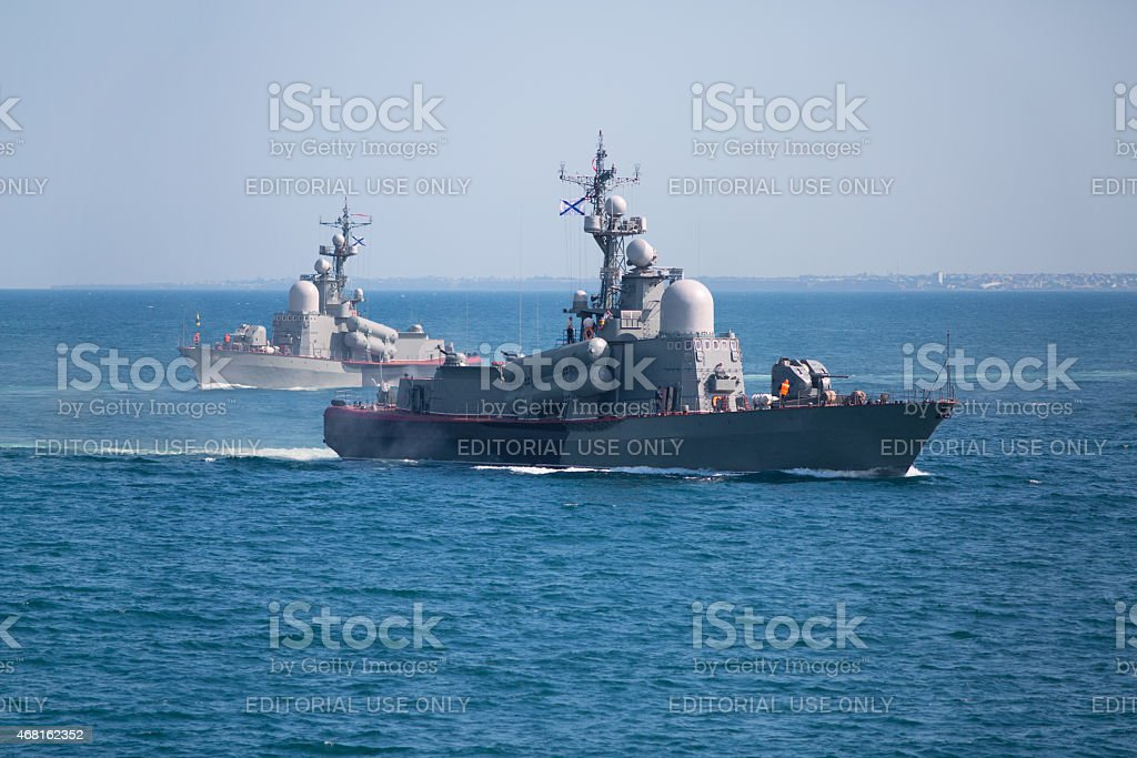 Two naval ships in the sea stock photo