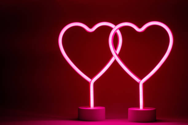 Two neon hearts stock photo