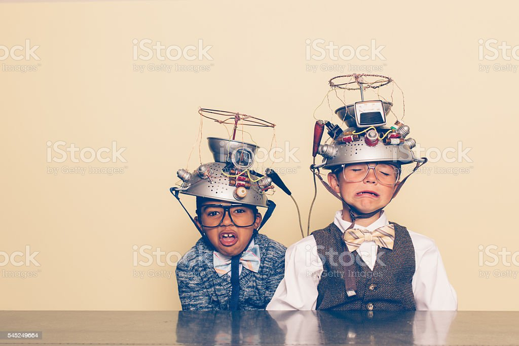 Two Nerd Boys Show Distress with Mind Reading Helmets stock photo