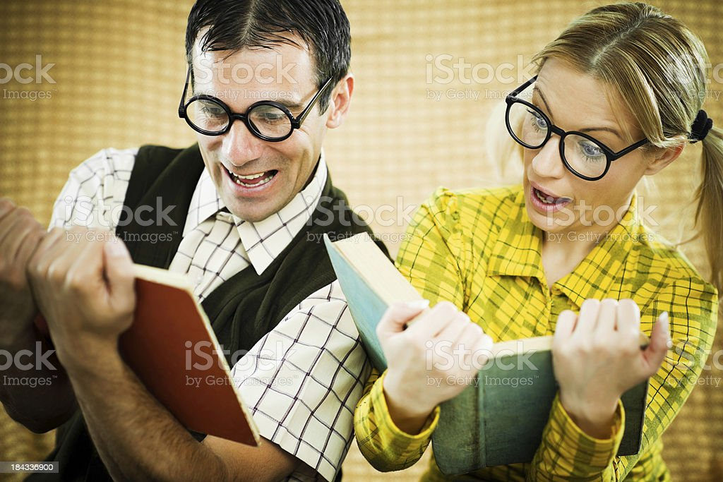 Two nerds reading books. royalty-free stock photo