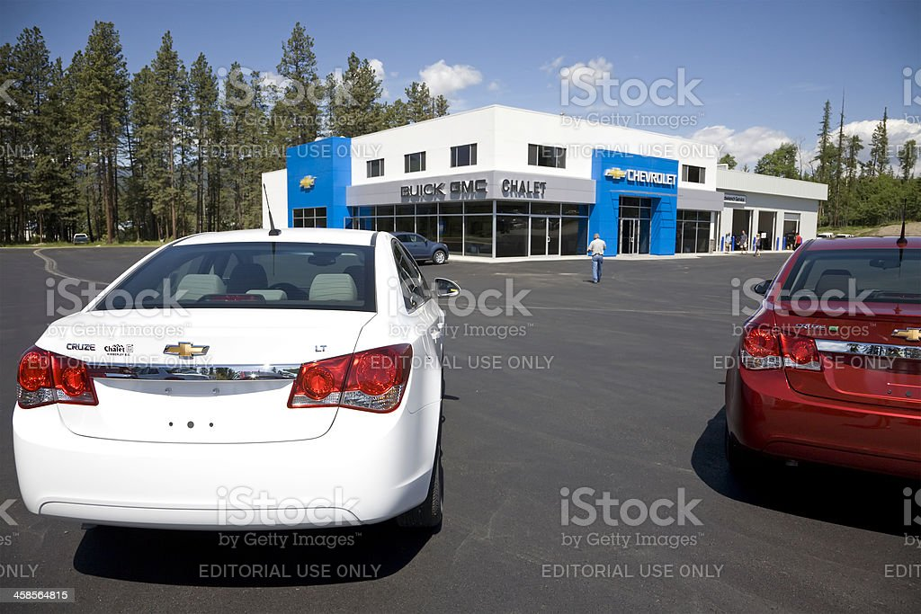 Two New Chevrolet Cruze Cars Parked in Dealership Lot stock photo
