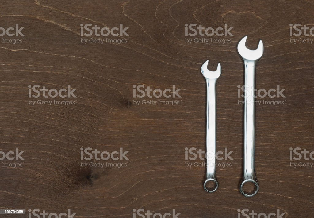 Two new Spanners or wrenches on wooden table foto stock royalty-free