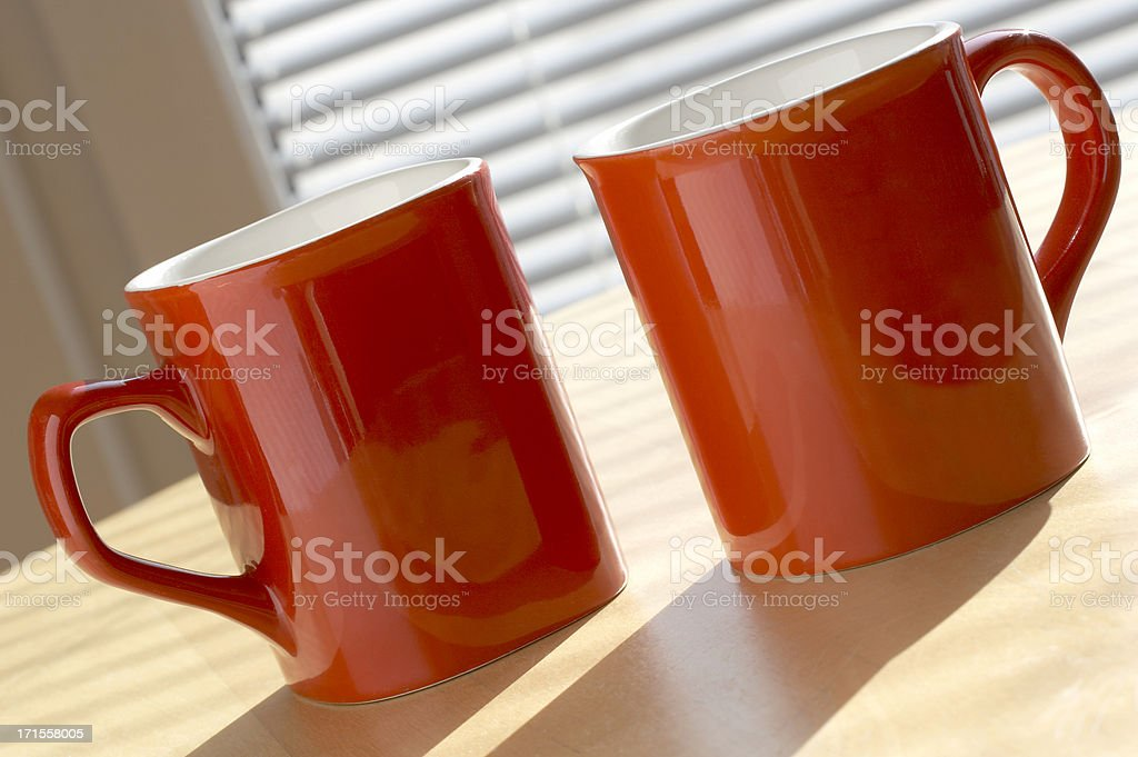 Two nice coffee mugs on the table royalty-free stock photo